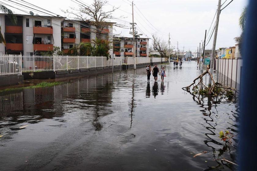 People walking in flood waters in Condado, San Juan, Puerto Rico, Sept. 22, 2017.